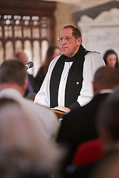 © Licensed to London News Pictures.  17/11/2013. THAME, UK. Canon David Wilbraham, Force Chaplain with the Thames Valley Police addresses the congregation during the annual Road Deaths Memorial Service held in St Marys Church, Thame. 78 people were killed in traffic accidents in the Thames Valley Police area last year.  Photo credit: Cliff Hide/LNP