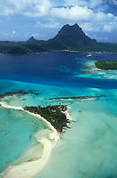French Polynesia, Islands in the South Pacific, part of the French overseas Territories.Photo by Owen Franken..aerial view of Bora Bora, with Motos (little islands)...Photo by Owen Franken