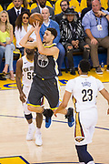 Golden State Warriors guard Klay Thompson (11) shoots a jump shot against the New Orleans Pelicans at Oracle Arena during Game 2 of the Western Semifinals in Oakland, California, on May 1, 2018. (Stan Olszewski/Special to S.F. Examiner)