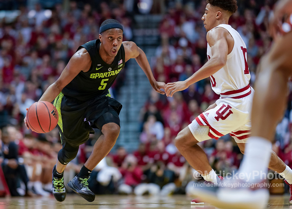 BLOOMINGTON, IN - MARCH 02: Cassius Winston #5 of the Michigan State Spartans dribbles the ball against Rob Phinisee #10 of the Indiana Hoosiers at Assembly Hall on March 2, 2019 in Bloomington, Indiana. (Photo by Michael Hickey/Getty Images) *** Local Caption *** Cassius Winston; Rob Phinisee