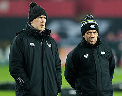 Ospreys' Head Coach Steve Tandy with Gruff Rees during the pre match warm up<br /> <br /> Photographer Simon King/Replay Images<br /> <br /> European Rugby Champions Cup Round 5 - Ospreys v Saracens - Saturday 13th January 2018 - Liberty Stadium - Swansea<br /> <br /> World Copyright © Replay Images . All rights reserved. info@replayimages.co.uk - http://replayimages.co.uk