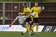 Burton Albion midfielder Owen Gallagher (22) battles for possession with Oxford United midfielder Mark Sykes(10) during the EFL Sky Bet League 1 match between Oxford United and Burton Albion at the Kassam Stadium, Oxford, England on 9 May 2021.