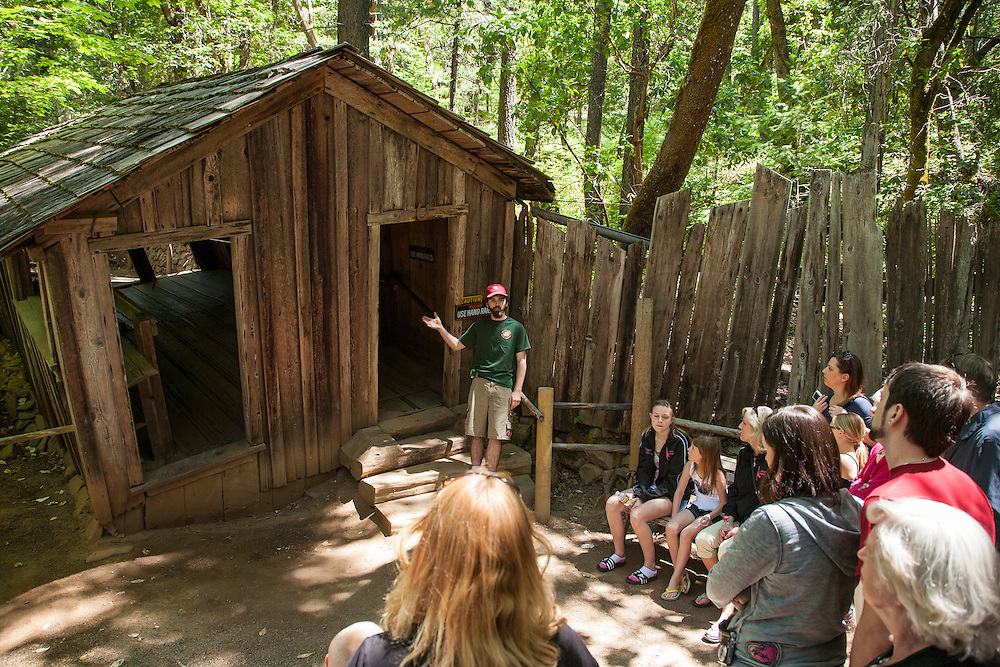 A guide demonstrates the various un-explained phenomena at The Oregon Vortex, and House of Mystery