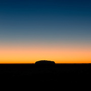Silhouette of Uluru with clear sky at sunrise