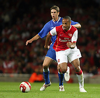 Photo: Chris Ratcliffe.<br /> Arsenal v Dinamo Zagreb. UEFA Champions League, Qualifying. 23/08/2006.<br /> Dino Drpic of Dynamo Zagreb clashes with Thierry Henry of Arsenal.