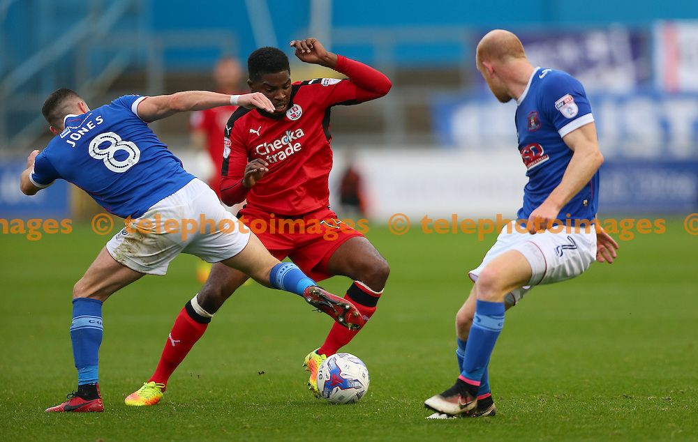 Crawley's Andre Blackman vies with Mike Jones of Carlisle during the Sky Bet League 2 match between Carlisle United and Crawley Town at Brunton Park in Carlisle. October 29, 2016.<br /> James Boardman / Telephoto Images<br /> +44 7967 642437