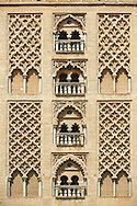 Moorish architectural detail on the old mosque tower, now the bell tower of the Cathedral of Seville, Spain . The Royal Alcázars of Seville (al-Qasr al-Muriq ) or Alcázar of Seville, is a royal palace in Seville, Spain. It was built by Castilian Christians on the site of an Abbadid Muslim alcazar, or residential fortress.The fortress was destroyed after the Christian conquest of Seville The palace is a preeminent example of Mudéjar architecture in the Iberian Peninsula but features Gothic, Renaissance and Romanesque design elements from previous stages of construction. The upper storeys of the Alcázar are still occupied by the royal family when they are in Seville. <br /> <br /> Visit our SPAIN HISTORIC PLACES PHOTO COLLECTIONS for more photos to download or buy as wall art prints https://funkystock.photoshelter.com/gallery-collection/Pictures-Images-of-Spain-Spanish-Historical-Archaeology-Sites-Museum-Antiquities/C0000EUVhLC3Nbgw <br /> .<br /> Visit our MEDIEVAL PHOTO COLLECTIONS for more   photos  to download or buy as prints https://funkystock.photoshelter.com/gallery-collection/Medieval-Middle-Ages-Historic-Places-Arcaeological-Sites-Pictures-Images-of/C0000B5ZA54_WD0s