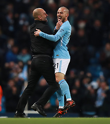 Manchester City's manager Pep Guardiola celebrates their last minute goal with David Silva