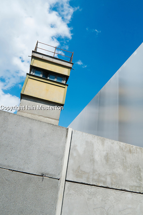 Section of original Berlin Wall with watchtower at Bernauer Strasse in Berlin Germany