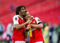 Arsenal's Mohamed Elneny (left) and Arsenal's Mesut Ozil celebrate together after the match  <br /> <br /> <br /> Photographer Craig Mercer/CameraSport<br /> <br /> The Emirates FA Cup Final - Arsenal v Chelsea - Saturday 27th May 2017 - Wembley Stadium - London<br />  <br /> World Copyright © 2017 CameraSport. All rights reserved. 43 Linden Ave. Countesthorpe. Leicester. England. LE8 5PG - Tel: +44 (0) 116 277 4147 - admin@camerasport.com - www.camerasport.com