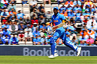 Cricket - 2019 ICC Cricket World Cup - Group Stage: India vs. Afghanistan<br /> <br /> India's captain Virat Kohli chases a single on his way to 67 before being caught by Rahmat Shah of Afghanistan of the bowling of Mohammad Nabi of Afghanistan at the Hampshire Bowl, Southampton. <br /> <br /> COLORSPORT/SHAUN BOGGUST