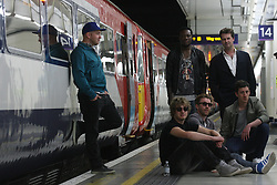 © Licensed to London News Pictures. 20/06/2012. London,Britain..Philip Sheppard, Olympic composer,Benga UK's leading premier dub step producer and The Milk Sony's hot tipped band for 2012 are posing together at the launch of Gatwick Express's Express Tracks.A photo call makes the launch of Gatwick Express's Express Tracks on Platform 13 in Victoria Station.  Photo credit : Thomas Campean/LNP..