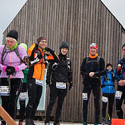 Rnners get ready to run.  Salomon Hammer Trail Winter Edition is a first on Bornholm and is one of the toughest routes in Denmark. The 4 runs consist of a 50 mile run, a marathon, a 1/2 marathon and 10k all run a on an approximate 25km route which includes 860 meter vertical rise on the North East coast of the Danish island Bornholm. The cut-off time for the 50mile run was 16 hours and more than a hundred runners made it to the finishing line. The last runner across the line after 50 miles  was in after 15:14:40