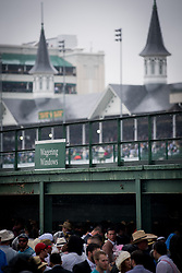 May 5, 2018 - Louisville, Kentucky, U.S. - Attendees stand in line, in the rain, to place their bet on Kentucky Derby Day in Louisville, Kentucky, Friday, May 5, 2018on Kentucky Derby Day at Churchill Downs in Louisville, Kentucky, Sunday, May 5, 2018. (Credit Image: © Bryan Woolston via ZUMA Wire)
