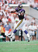 Minnesota Vikings quarterback Warren Moon (1) leaps as he throws a pass during the NFL football game against the Tampa Bay Buccaneers on Oct. 15, 1995 in Tampa, Fla. The Bucs won the game 20-17 in overtime. (©Paul Anthony Spinelli)