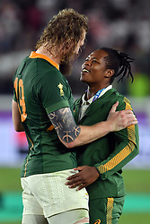 South Africa's RG Snyman (left) with Sbu Nkosi after the 2019 Rugby World Cup final match at Yokohama Stadium.
