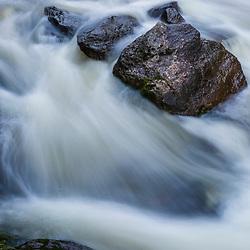The Presumpscot River at Presumpscot Falls in Portland, Maine. Spring.