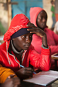 Young men are training to become mechanics as part of the Into Work programme run by Action for children in conflict (AFCIC) in Thika, Kenya.  They go to school between 7 and 9 am to learn literacy and maths, followed by going to various garages to learn the practical skills.
