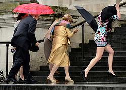 © Licensed to London News Pictures. 14/05/2012. City of London, UK People arriving for the service  run from the rain. The Dalai Lama arrives at St Paul's Cathedral today 14 may 2012 to be presented with the £1.1m Templeton annual prize in his first visit to the Cathedral. The award is for a living person who has 'made an exceptional contribution to affirming the spiritual dimension of life'.. Photo credit : Stephen Simpson/LNP
