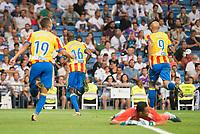 Valencia's Rodrigo Moreno, Geoffrey Kondogbia and Simone Zaza celebrating a goal during La Liga match between Real Madrid and Valencia CF at Santiago Bernabeu Stadium in Madrid, Spain August 27, 2017. (ALTERPHOTOS/Borja B.Hojas)
