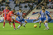 Ryan Jackson (Gillingham) takes a shot during the Sky Bet League 1 match between Wigan Athletic and Gillingham at the DW Stadium, Wigan, England on 7 January 2016. Photo by Mark P Doherty.