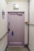 purple metal door seen from the inside of an apartment Japan