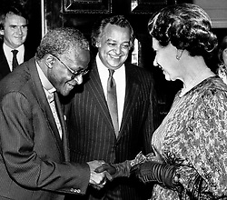Queen Elizabeth II meets the Anglican Archbishop of Cape Town, Desmond Tutu at a Commonwealth Day Reception at Marlborough House, London, with Sir Shridath Ramphal, Secretary-General of the Commonwealth, looking on.
