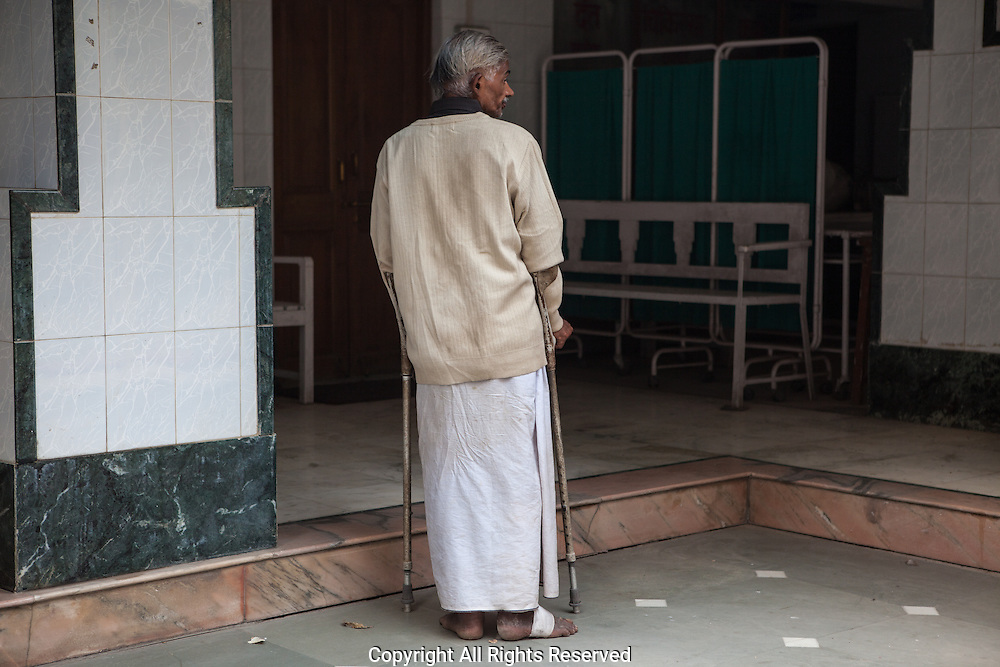 A patient with partial leprosy makes his way to the clinic for treatment.