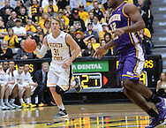 WICHITA, KS - JANUARY 05:  Guard Ron Baker #31 of the Wichita State Shockers brings the ball up court against the Northern Iowa Panthers during the first half on January 5, 2014 at Charles Koch Arena in Wichita, Kansas.  (Photo by Peter G. Aiken/Getty Images) *** Local Caption *** Ron Baker