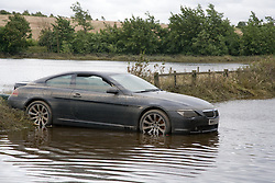 Car stranded and underwater following the floods at Toll Bar; South Yorkshire; July 2007,