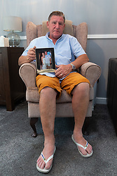 DAILY MIRROR Peter Crouch at his home in Loughton, Essex, holds a picture taken on the day he married Lynn. He is battling with officials from the Dominican Republic for the return of his late wife's complete body after she passed away whilst on holiday on the island . Loughton, Essex, July 17 2019.
