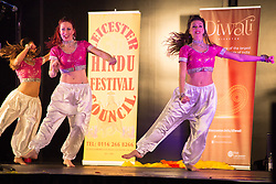"""© Licensed to London News Pictures. 01/11/2015. Leicester, UK. More than 35,000 people were estimated to have attended the annual Diwali ight switch-on which took place along the named """"Golden Mile"""" in Belgrave Road, Leicester. Pictured, Diwali dancers taking part in the switch-on ceremony. Photo credit : Dave Warren/LNP"""
