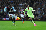 Kelechi Iheanacho of Manchester city  ® breaks past Micah Richards of Aston Villa.  Barclays Premier league match, Aston Villa v Manchester city at Villa Park in Birmingham, Midlands  on Sunday 8th November 2015.<br /> pic by  Andrew Orchard, Andrew Orchard sports photography.