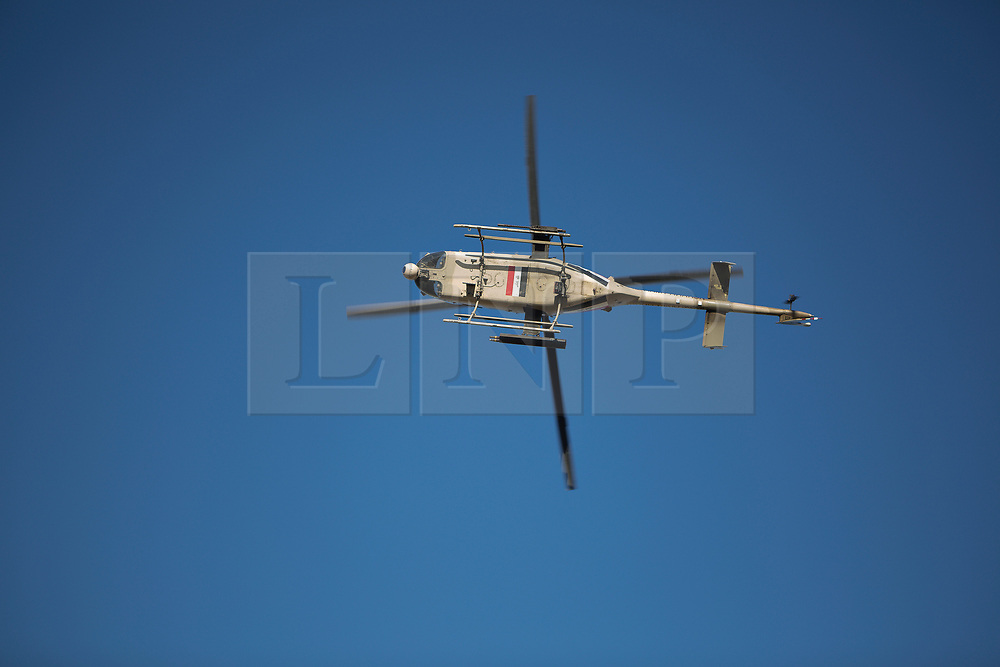 20/02/2017. Albu Saif, Iraq. With an Iraqi Army Aviation attack helicopter IA-407 flies over Iraqi Security Force reinforcements moving into the village of Albu Saif as part of the ongoing offensive to retake western Mosul from the Islamic State.<br /> <br /> Iraqi forces reported today that one of its attack helicopters, supporting the ongoing Mosul Offensive, was shot down by Islamic State militants.
