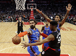 March 8, 2019 - Los Angeles, California, U.S - Los Angeles Clippers' Tyrone Wallace (9) looks to pass the ball goes to basket while defended by Oklahoma City Thunder's Steven Adams (12) and Oklahoma City Thunder's Terrance Ferguson (23) during an NBA basketball game between Los Angeles Clippers and Oklahoma City Thunder Friday, March 8, 2019, in Los Angeles. (Credit Image: © Ringo Chiu/ZUMA Wire)