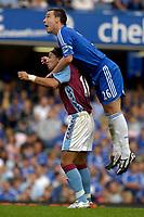 Photo: Daniel Hambury.<br />Chelsea v Aston Villa. The Barclays Premiership. 30/09/2006.<br />Chelsea's John Terry climbs above Villa's Juan Pablo Angel.