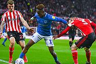 Jamal Lowe of Portsmouth (10) and Max Power of Sunderland (27) in action during the EFL Sky Bet League 1 first leg Play Off match between Sunderland and Portsmouth at the Stadium Of Light, Sunderland, England on 11 May 2019.