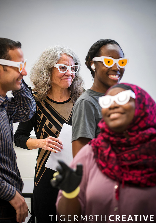 HHS Professor and Gerontology Program Director Rebecca G. Adams, back center, leads her class during an aging sensitivity experience.