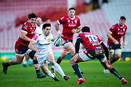 Sam Hidalgo-Clyne of Exeter Chiefs under pressure from Santiago Carreras of Gloucester Rugby during the Gallagher Premiership Rugby match between Gloucester Rugby and Exeter Chiefs at the Kingsholm Stadium, Gloucester, United Kingdom on 26 March 2021.