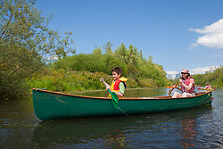 North America, United States, Washington, Bellevue, woman and boy (age 9) kayaking in Mercer Slough Nature Park.  MR