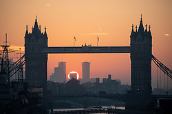 © Licensed to London News Pictures. 10/10/2018. London, UK. The sun rises through Tower Bridge in London, as the capital expects unseasonably warm weather later in the day, with temperatures set to reach up to 23 degrees Celsius. Photo credit : Tom Nicholson/LNP