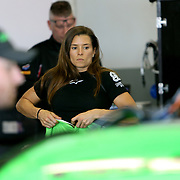 Danica Patrick, driver of the #7 GoDaddy Chevrolet is seen prepping herself in the garage area during practice for the 60th Annual NASCAR Daytona 500 auto race at Daytona International Speedway on Friday, February 16, 2018 in Daytona Beach, Florida.  (Alex Menendez via AP)