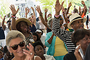 Family members of Myra Thompson, killed in the Mother Emanuel African Methodist Episcopal Church shooting join in song during a memorial service marking the 2nd anniversary of the mass shooting June 17, 2017 in Charleston, South Carolina. Nine members of the historic African-American church were gunned down by a white supremacist during bible study on June 17, 2015.