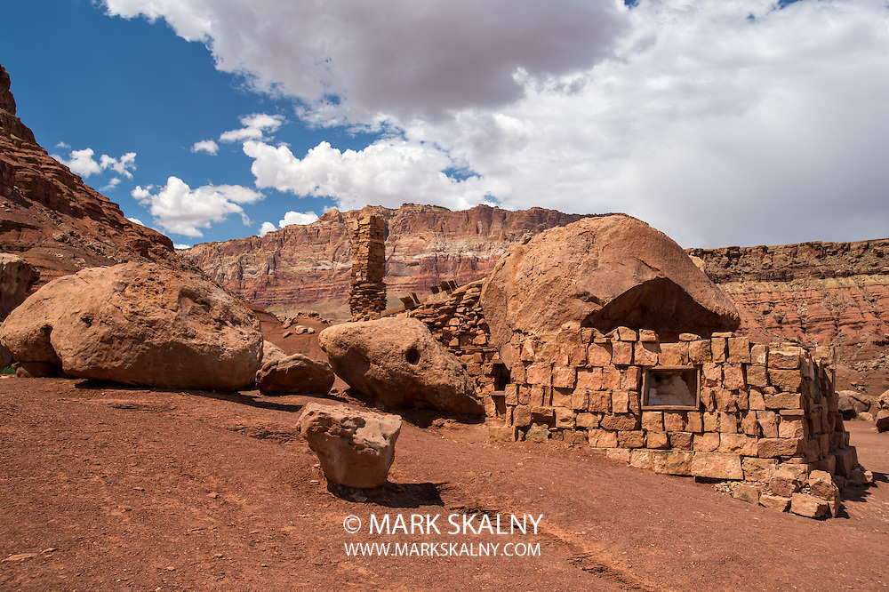 Native American home in Cliff Dwellers, located in Northern Arizona at Marble Canyon and at the foot of Vermillion Cliffs, is known for its unique shaped boulders and rugged terrain.