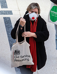 © Licensed to London News Pictures. 16/03/2020. London, UK. A London worker in a mask at a quiet Victoria Station this morning as Government ministers warn that over 70s will face self-isolation for weeks as the Coronavirus disease pandemic continues . Photo credit: Alex Lentati/LNP