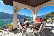 Architecture, nice porch with table and chairs, lake view