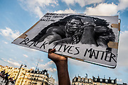 Paris, France, 03/06/20   A protester is holding up a sign of George Floyd during a Black Lives Matter protest in Paris.