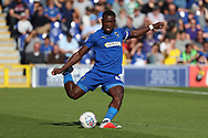 AFC Wimbledon defender Deji Oshilaja (4) passing the ball during the EFL Sky Bet League 1 match between AFC Wimbledon and Oxford United at the Cherry Red Records Stadium, Kingston, England on 29 September 2018.
