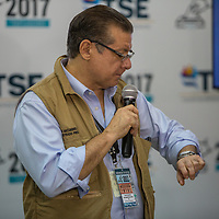 David Matamorros, the top magistration of the Supreme Electoral Tribunal, the TSE, looks at his watch. The election results, that he was responsible for delivering were three weeks late and evidence of widespread fraud were abundant.