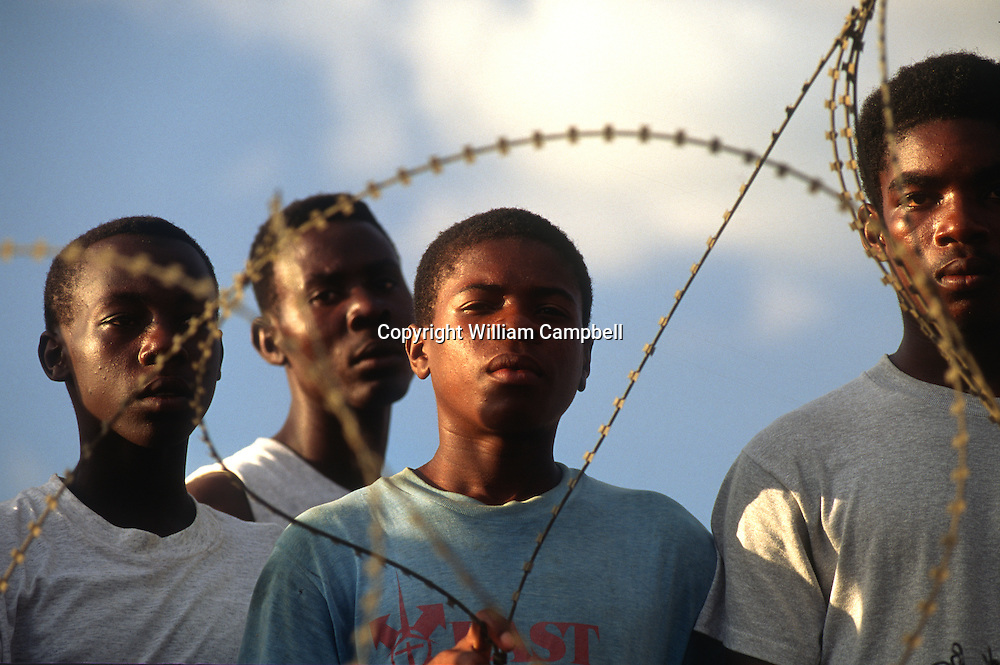 """Haitian refugees held at Guantanamo Bay Naval Station 9/27/94Haitian refugees held at Guantanamo Bay Naval Station 9/27/94Haitian refugees held at Guantanamo Bay Naval Station 9/27/94.Haitian refugees at Camp Buckley at the Guantanamo Bay Naval Station in Cuba 1991. Thousands of Haitian refugees heading to the US were stopped at sea and taken to GTMO as part of """"operation Safe Haven."""""""